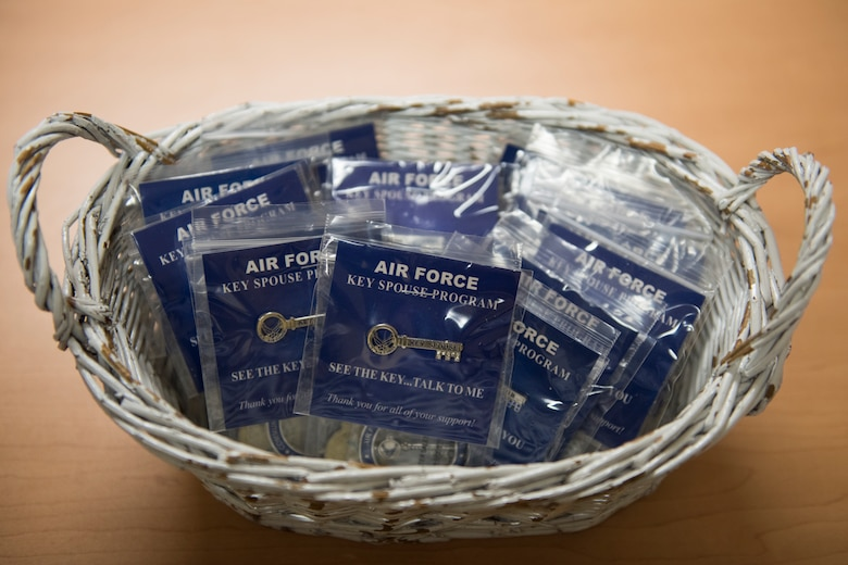 Key-shaped pins, awarded to Key Spouses following initial training, sit in a basket at Joint Base Elmendorf-Richardson, Alaska, Oct. 16, 2018. Key Spouses are selected by unit commanders to provide support for their squadron's families.