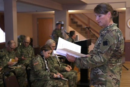 88th Readiness Division Blue Devils Music Unit, Chief Warrant Officer Three Sharon Toulouse, 312th Army Band Executive Officer, examines sheet music before leading the 88th Readiness Division Blue Devils Music Unit during the U.S. Army Reserve Music Sergeant Major change of responsibility ceremony at Fort McCoy, Wisconsin, October 20, 2018.