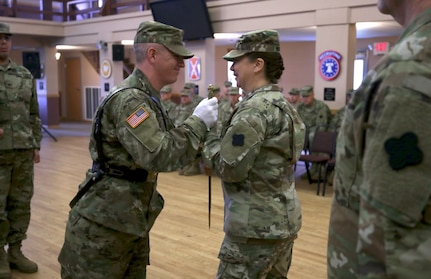Sgt. Benjamin Moran, 338th Army Band, 88th Readiness Division, passes an 1840 U.S. noncommissioned officers sword to Command Sgt. Maj. Sara E. Noskowiak during a change of responsibility ceremony at Fort McCoy, Wisconsin, Oct. 20, 2018.