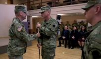 Maj. Gen. Patrick J. Reinert, commanding general of the 88th Readiness Division, hands an 1840 noncommissioned officer musicians sword to Master Sgt. Keith M. Barlow. The sword passing represents relinquishing responsibility from the outgoing senior noncomissioned officer to the incoming noncomissioned officer.