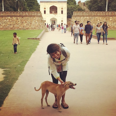 U.S. Air Force Capt. Krystal Lowder, 33rd Fighter Wing Protocol chief of protocol, pets a dog Aug. 25 ,2018, in New Delhi, India. Lowder was accepted into the Air Force's LEAP program. LEAP identifies and cultivates the existing foreign language skills of Airmen for the life of their career. (Courtesy photo)