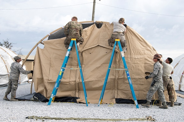 U.S. Air Force Airmen building tents