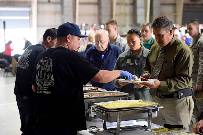 Participants grab food during Retiree Appreciation Day at the Louis F. Garland Department of Defense Fire Academy on Goodfellow Air Force Base, Texas, Oct. 25, 2018. Goodfellow provided free food, refreshments, music and a regulation drill display to the participants. (U.S. Air Force photo by Senior Airman Randall Moose/Released)