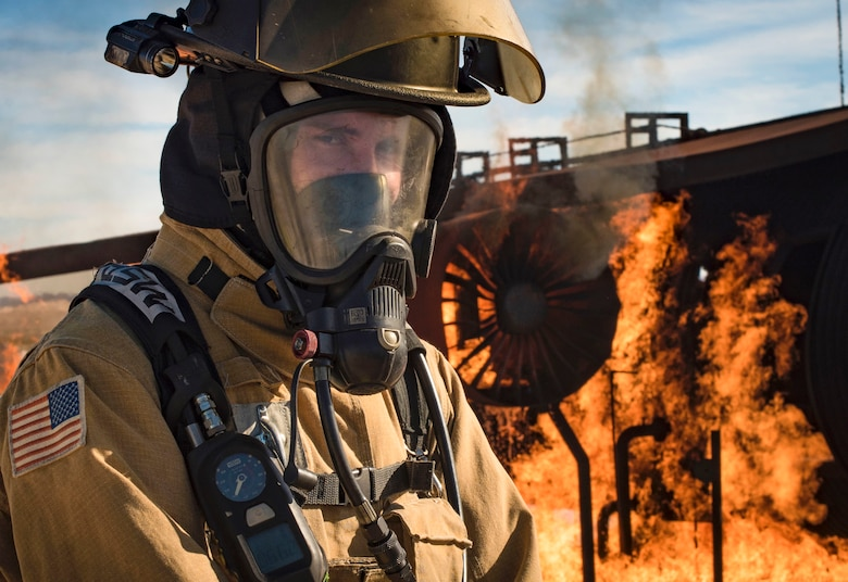 Staff Sgt. Brice Haylett, 99th Civil Engineer Squadron firefighter, catches his breath before instructing his team on proper firefighting procedures during a training exercise Oct. 23, 2018, at Nellis Air Force Base, Nev. More than a dozen firefighters from Nellis, Creech and Clark County Fire Departments participated in the exercise. (U.S. Air Force photo by Airman 1st Class Andrew D. Sarver)