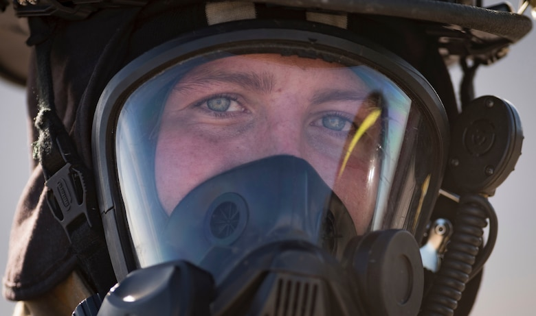 Senior Airman Dalton Kendall, 99th Civil Engineer Squadron firefighter, catches his breath after conducting a firefighter training exercise Oct. 23, 2018, at Nellis Air Force Base, Nev. Kendall was one of more than a dozen Nellis, Creech and Clark County firefighters to participate in the training. (U.S. Air Force photo by Airman 1st Class Andrew D. Sarver)