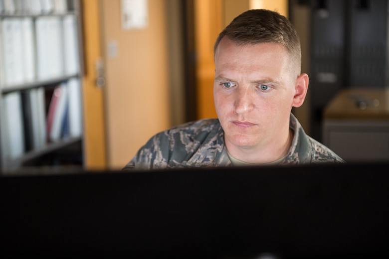 Senior Airman Kyle Prestwood, 2nd Operations Support Squadron weather forecaster, verifies observations at Barksdale Air Force Base La., Oct. 10, 2018. The weather flight has a sensor on the airfield that can detect the location of lightning strikes. (U.S. Air Force photo by Airman 1st Class Lillian Miller)