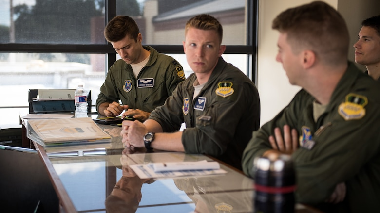 Barksdale aircrew prepare for a weather brief at Barksdale Air Force Base La., Oct. 10, 2018. The 2nd Operations Support Squadron weather flight briefed approximately 1,200 crews throughout 2017 on the forecast and the impact it would have on their flight. (U.S. Air Force photo by Airman 1st Class Lillian Miller)