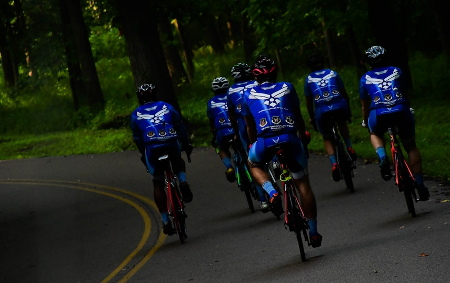 Members of the Scott Air Force Base, Ill., Cycling Team ride through O'Fallon, Ill., during a training ride, July 12, 2018. The 2018 team consists of seven riders and one support member who train on a regular basis to ensure their riding abilities are as sharp as possible. (U.S. Air Force photo by Staff Sgt. Michael Cossaboom)