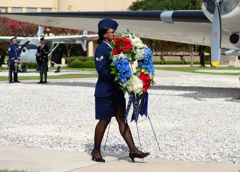 U.S. Air Force Airman 1st Class Janaya Fulton, 625th Operations Center, carries a memorial wreath during the Twenty-Fifth Air Force Remembrance Ceremony at Joint Base San Antonio – Lackland, Sept. 28, 2018. The ceremony is held every year to honor the fallen silent warriors from the previous 12 months. (U.S. Air Force Photo by Gloria Vasquez)