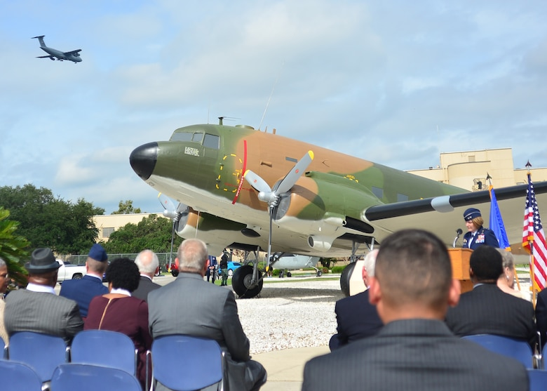 During the Twenty-Fifth Air Force's Remembrance Ceremony at Joint Base San Antonio – Lackland, Sept. 28, 2018, a C-5 aircraft from the 433rd Airlift Wing flies over while U.S. Air Force Maj. Gen. Mary O'Brien, Twenty-Fifth Air Force commander, speaks about the organization's losses during its 70 Years in the Fight. (U.S. Air Force Photo by Alexx Pons)