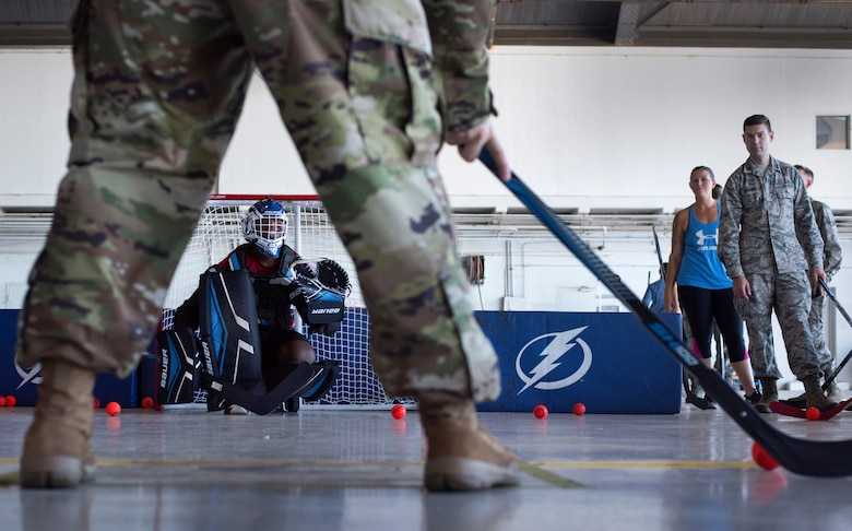 U.S. Air Force Airman 1st Class Ried Patton, an administrator assigned to the 6th Operation Support Squadron, defends a goal during street hockey practice at MacDill Air Force Base, Florida, Oct. 25, 2018.