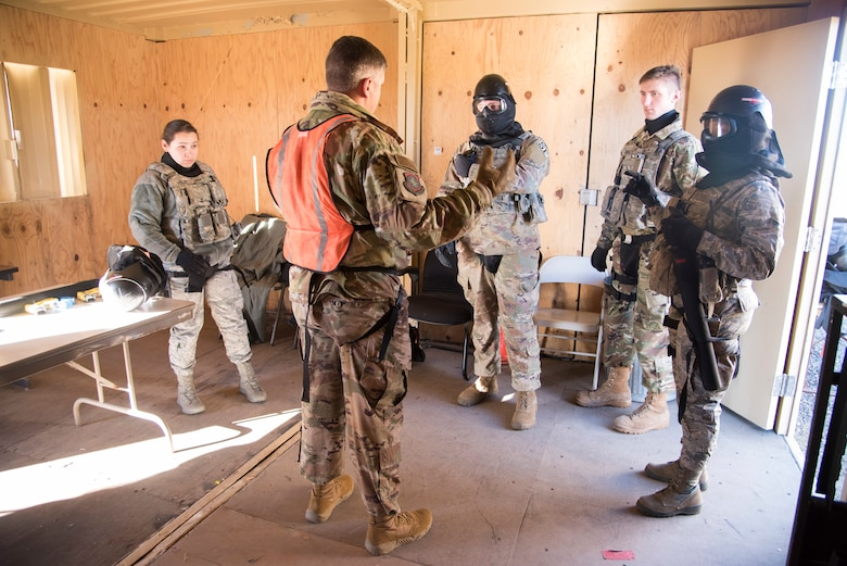 Airmen from the 92nd Security Forces Squadron are briefed on scenarios they may face during a high-risk situation training exercise at Fairchild Air Force Base, Washington, Oct. 15, 2018. SFS instructors provided immediate feedback to trainees on what went well and new approaches they may take to achieve a better outcome after each completed scenario. (U.S. Air Force photo/ Senior Airman Ryan Lackey)
