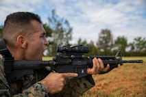 Cpl. Alberto Castillolopez screams out instructions to his fireteam during a fire and movement range Oct. 24, 2018, at Camp Hansen, Okinawa, Japan. During the range, Marines with 3rd Marine Logistics Group practiced their marksmanship skills, improved their communication and worked on their weapons handling while engaging targets. Castillolopez is a native of Riverside, California, is a machine gunner with the Tactical Readiness and Training, G-3, 3rd MLG Headquarters. (U.S. Marine Corps photo by Lance Cpl. Terry Wong)