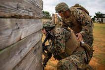 Staff Sgt. Ryan Betonie, right, orders Lance Cpl. Jonathan Zhinin, left, to engage the target during a fire and movement range Oct. 24, 2018, at Camp Hansen, Okinawa, Japan. During the range, Marines with 3rd Marine Logistics Group practiced their marksmanship skills, improved their communication and worked on their weapons handling while engaging targets. Betonie is a native of Lukachukai, Arizona, and is an infantry unit leader with Tactical Readiness and Training, G-3, 3rd MLG Headquarters. Zhinin is a native of Orange, New Jersey, is a food service specialist with Food Service Company, Headquarters Regiment, 3rd MLG. (U.S. Marine Corps photo by Lance Cpl. Terry Wong)