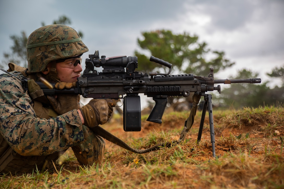 Cpl. Daniel Divirgilio fires a M249 Light Machine Gun at a target during a fire and movement range Oct. 24, 2018, at Camp Hansen, Okinawa, Japan. During the range, Marines with 3rd Marine Logistics Group practiced their marksmanship skills, improved their communication and worked on their weapons handling while engaging targets. Divirgilio is a native of Grafton, Massachusetts, is a machine gunner with the Tactical Readiness and Training, G-3, 3rd MLG Headquarters. (U.S. Marine Corps photo by Lance Cpl. Terry Wong)