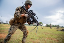 Cpl. Levi Galindo sprints towards his next position during a fire and movement range Oct. 24, 2018, at Camp Hansen, Okinawa, Japan. During the range, Marines with 3rd Marine Logistics Group practiced their marksmanship skills, improved their communication and worked on their weapons handling while engaging targets. Galindo is a native of Las Vegas, Nevada, and is a machine gunner with the Tactical Readiness and Training, G-3, 3rd Marine Logistics Group Headquarters. (U.S. Marine Corps photo by Lance Cpl. Terry Wong)
