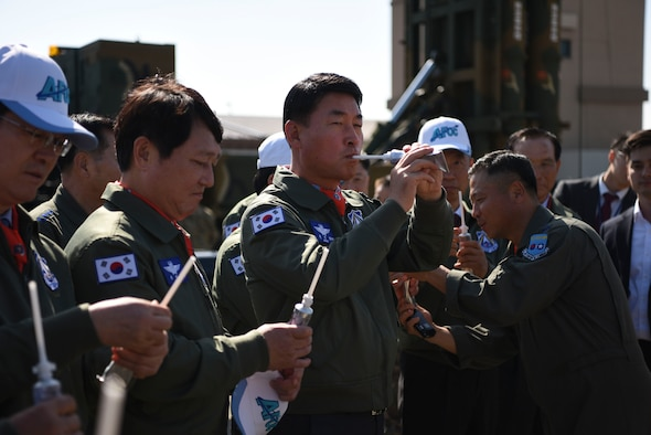 Members of the Republic of Korea National Defense Committee sample liquidized food typically eaten through a tube by U-2 pilots assigned to the 5th Reconnaissance Squadron during long flights at Osan Air Base, ROK, Oct. 25, 2018. U.S. Air Force pilots offered liquid samples of hash browns with bacon, beef stroganoff and chocolate pudding. (U.S. Air Force photo by Airman 1st Class Ilyana A. Escalona)