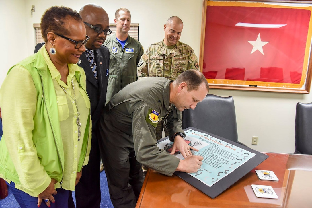 U.S. Air Force Brig. Gen. Gentry Boswell, 36 Wing Commander, signs a proclamation kicking off Red Ribbon week at Andersen Air Force Base, Guam, Oct. 26, 2018. (U.S. Air Force photo by Senior Airman Christopher Quail)