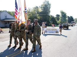 "MULDRAUGH, Ky. - The 1st Theater Sustainment Command color guard marches in the Muldraugh ""Down Home Days"" parade, Oct. 6. The chief of staff and his wife served as the grand marshals for the parade. The 1st TSC also provided a HMMV for the parade. The 1st TSC is honored to be partnered with the community of Muldraugh. (U.S. Army photos by Mr. Brent Thacker)"
