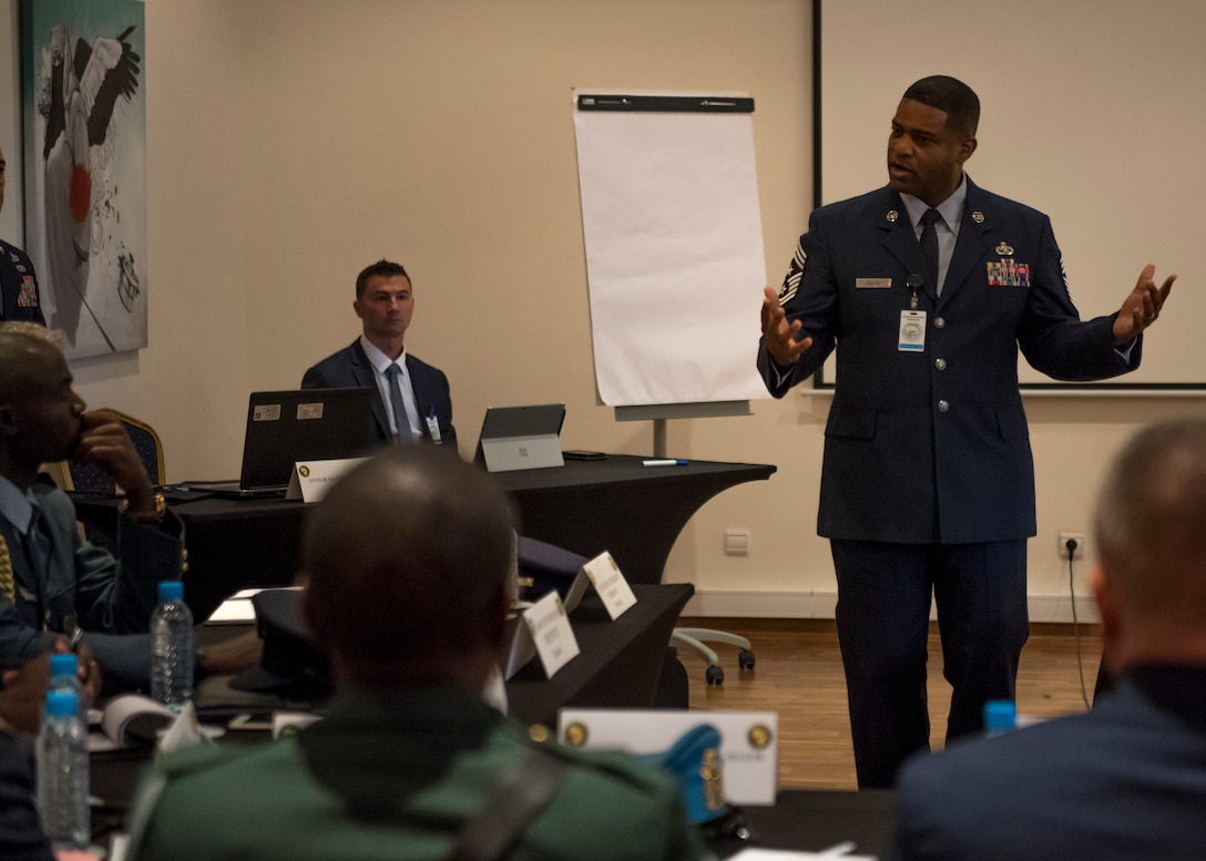 Chief Master Sergeant Phillip L. Easton, USAFE-AFAFRICA Command Chief, addresses a room of senior enlisted African military officials during the 8th annual African Air Chiefs Symposium (AACS). This year marks the first time in the history of AACS that African enlisted leaders participated  with the air chiefs to discuss African air defense issues and ways to increase military cooperation. (DoD photo by Mass Communication Specialist 2nd Class Cody Hendrix/Released)