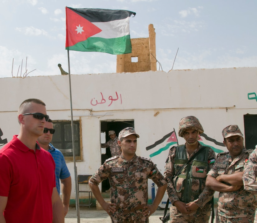 U.S. Army Capt. Jeffrey Koehler, operations officer with the 157th Military Engagement Team, Wisconsin National Guard, and Jordanian Armed Forces soldiers discuss border guard securities operations, Oct. 8, 18, near Amman, Jordan. Security is a very important factor in maintaining force readiness.
