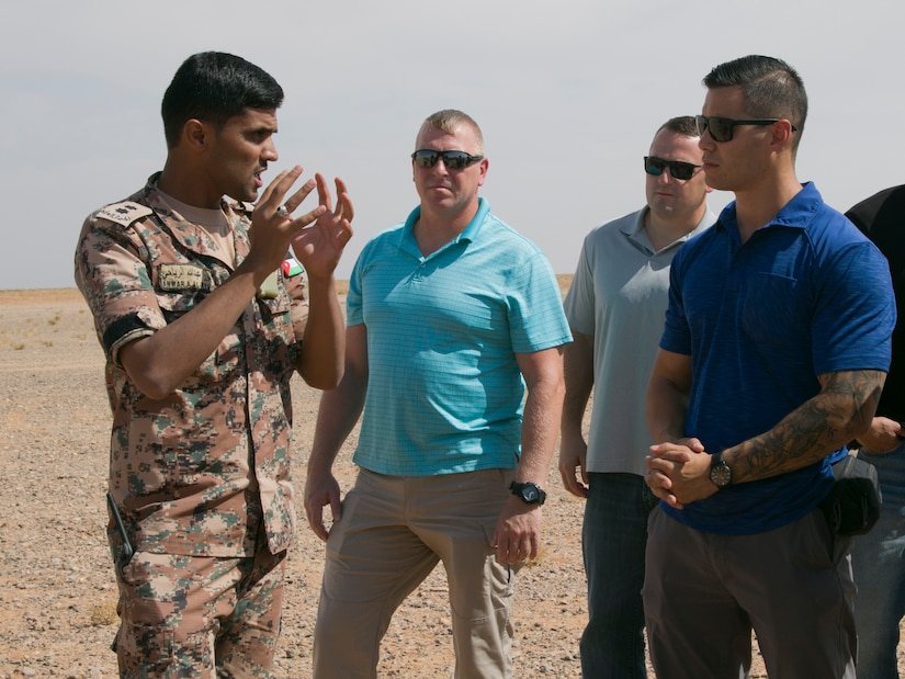 Jordan Armed Forces 1st Lt. Anwar A. Al Ryahi, a platoon leader with the 4th Battalion Border Guard Force, explains the importance of the Javelin missile to U.S. Army Staff Sgt. Joseph Wong, assistant operations NCO with the 157th Military Engagement Team, Wisconsin Army National Guard, during a simulated quick-reaction force battle drill, Oct., 18, near Amman, Jordan. The Javelin is an anti-tank missile capable of defeating modern tanks by attacking them from above.
