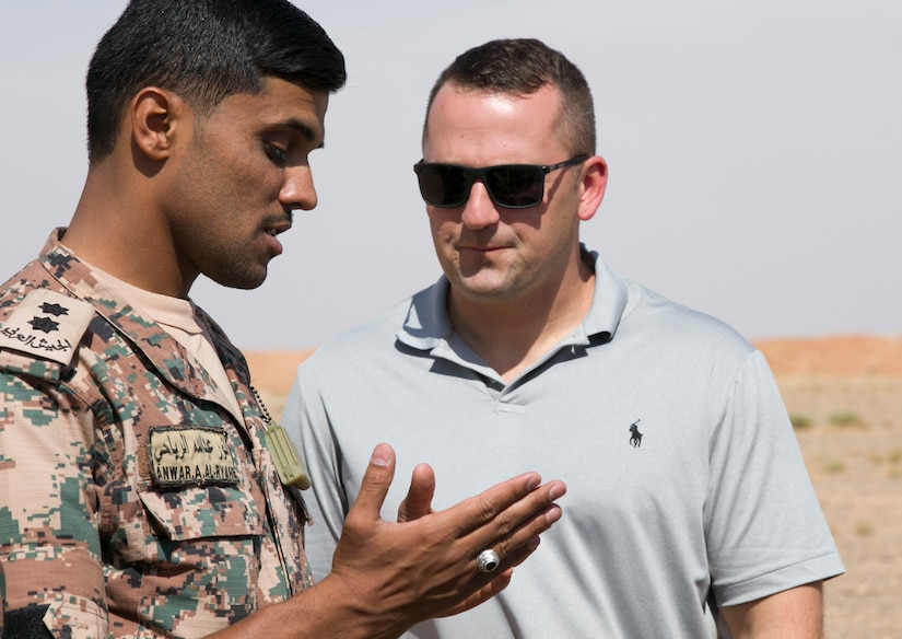 Jordan Armed Forces 1st Lt. Anwar A. Al Ryahi, 4th Battalion Border Guard Force Platoon Leader, explains quick-reaction force tactics to U.S. Army Master Sgt. Michael Pembroke, future operations NCO with the 157th Military Engagement Team-Kuwait, Wisconsin National Guard, how the JAF prepare for react-to-contact training missions, Oct. 7, 18, near Amman, Jordan. Joint military engagements promote continuity among allied nations and allow a better understanding of each nations capabilities.