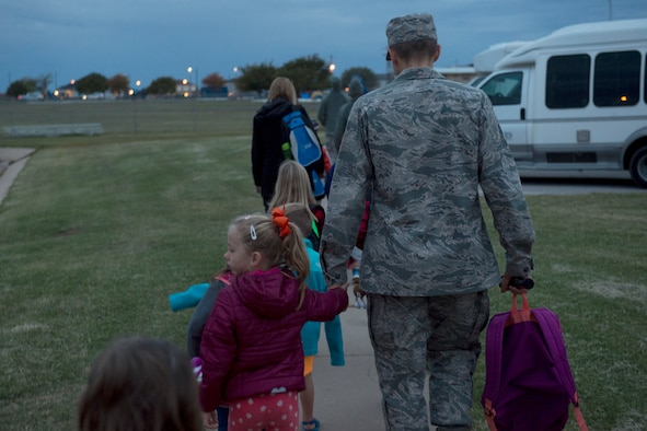 Students of L. Mendel Rivers Elementary School walk to school with teachers and Company Grade Officers, October 24, 2018, at Altus Air Force Base, Okla.