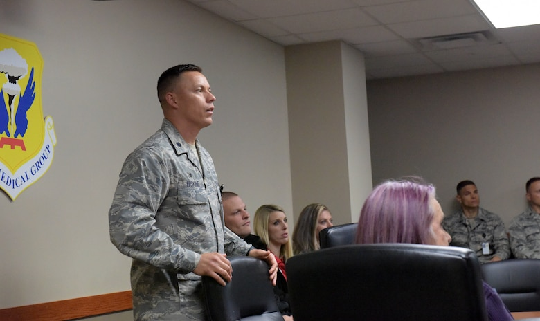 Lt. Col. Ian Erskine, the 509th Medical Support Squadron commander, briefs Tricare network providers Oct. 19, 2018 at Whiteman Air Force Base, Missouri. Regional providers, including those from Warrensburg, Knob Noster and Sedalia, Missouri, came to the installation to learn the mission, see how their services support it and get up close with a B-2. (U.S. Air Force photo by Staff Sgt. Joel Pfiester)