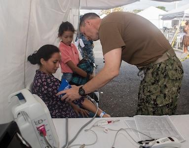 A U.S. Navy doctor takes a patient's vitals in Ecuador.