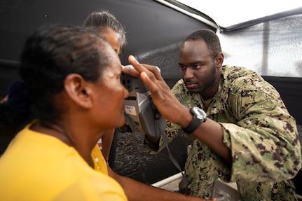 Hospital Corpsman 3rd Class Brandon Williams checks a patient's eyesight in Ecuador.