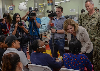 Ambassador Liliana Ayalde, civilian deputy to the commander, foreign policy advisor, U.S. Southern Command, meets with patients aboard the hospital ship USNS Comfort.