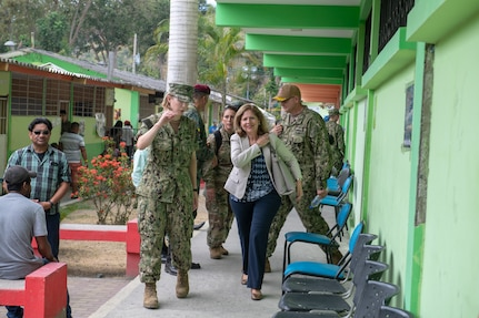 Lt. Cmdr. Amanda Antonio, officer-in-charge of one of two medical sites, escorts Ambassador Liliana Ayalde, civilian deputy to the commander, foreign policy advisor, U.S. Southern Command, around the medical site.