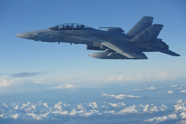 An F/A-18D Hornet, with Marine All-Weather Fighter Attack Squadron (VMFA) 224, conducts an aerial refuel in Norway, during Exercise Trident Juncture 18, Oct. 24, 2018. Trident Juncture 18 enhances the U.S. and NATO Allies' and partners' abilities to work together collectively to conduct military operations under challenging conditions. (U.S. Marine Corps photo by Gunnery Sgt. Christopher Giannetti)