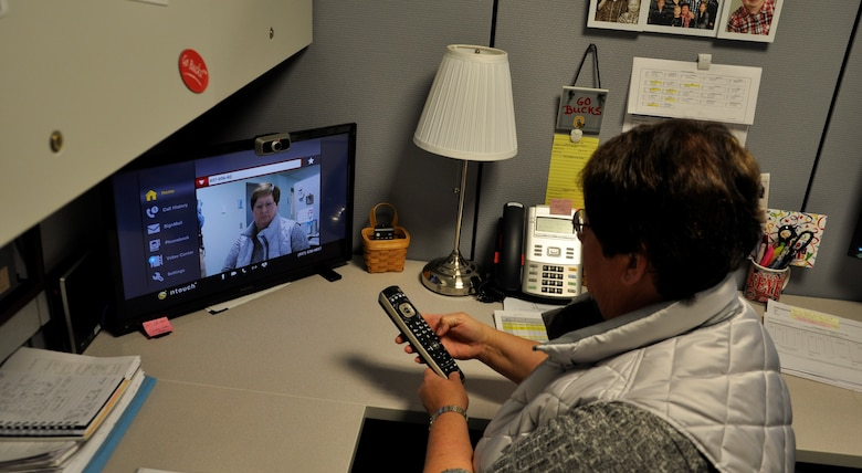 Anita Kerns, a financial specialist at the 711th Human Performance Wing, demonstrates how she uses the Sorenson video phone. Kerns has worked at Wright-Patterson Air Force Base for over 30 years and has been profoundly deaf since the age of two. Any obstacles Kerns has with communication are resolved through several means of technology methods such as email, instant, or text messages, requesting interpreters, or video phone. (U.S. Air Force photo/Loren Deer)