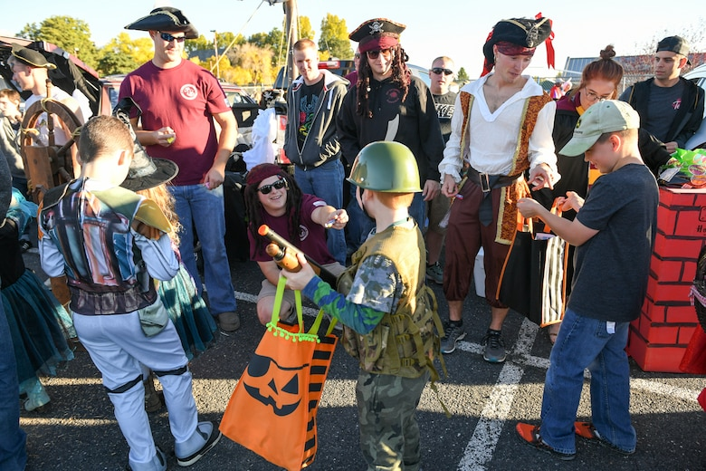Airmen from the Airmen Leadership School hand Halloween treats to Trunk-or-Treaters during the Haunting on the Hill celebration Oct. 19, 2018 at Hill Air Force Base, Utah. (U.S. Air Force photo by Cynthia Griggs)