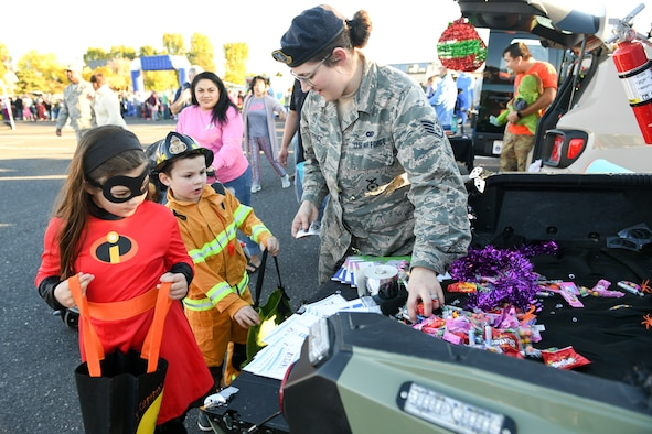 Chief Master Sgt. Rodney Koonce, 75th Air Base Wing Command Chief is approached by Miya Suiter in her handmade peacock costume during the Haunting on the Hill celebration Oct. 19, 2018 at Hill Air Force Base, Utah. (U.S. Air Force photo by Cynthia Griggs)