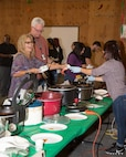 Employees from Fleet Support Division enjoy trying various chilis during their annual Chili Cookoff event held on the Yermo Annex aboard Marine Corps Logistics Base Barstow, Calif., Oct. 24. Four judges tasted 19 chili varations and selected their top three favorites, awarding prizes to the winners. By all accounts, it was a close call!