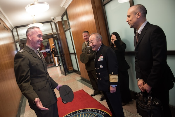 U.S. Chairman of the Joint Chiefs of Staff Gen. Joe Dunford speaks with his counterpart Japanese Chief of Staff Adm. Katsutoshi Kawano before multilateral meetings between U.S., Japanese, and Republic of Korean military officials at the Pentagon, Oct. 26, 2018.