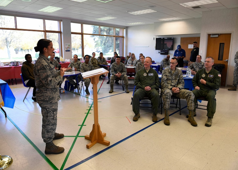 """Capt. Alyssa Armstrong, 92nd Logistics Readiness Squadron Material Management Flight commander, gives opening remarks for a """"Chili Cook-Off"""" event promoting the 2018 Combined Federal Campaign Kick-Off at Fairchild Air Force Base, Washington, Oct. 24, 2018.  Fairchild's 92nd Air Refueling Wing CFC representatives hosted a """"Chili Cook-Off"""" event, allowing Airmen to engage with local charities and nonprofit organizations. (U.S. Air Force photo/Airman 1st Class Lawrence Sena)"""