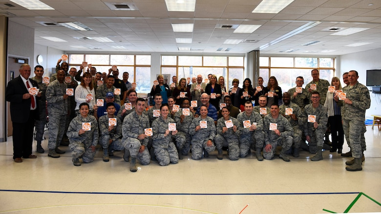 """Airmen and representatives from local charities and nonprofit organizations pose for a photo as part of a """"Chili Cook-Off"""" event promoting the 2018 Combined Federal Campaign Kick-Off at Fairchild Air Force Base, Washington, Oct. 24, 2018. Nine local charities and nonprofit organizations were represented at the event, giving them the opportunity to engage with the Airmen who attended. (U.S. Air Force photo/Airman 1st Class Lawrence Sena)"""