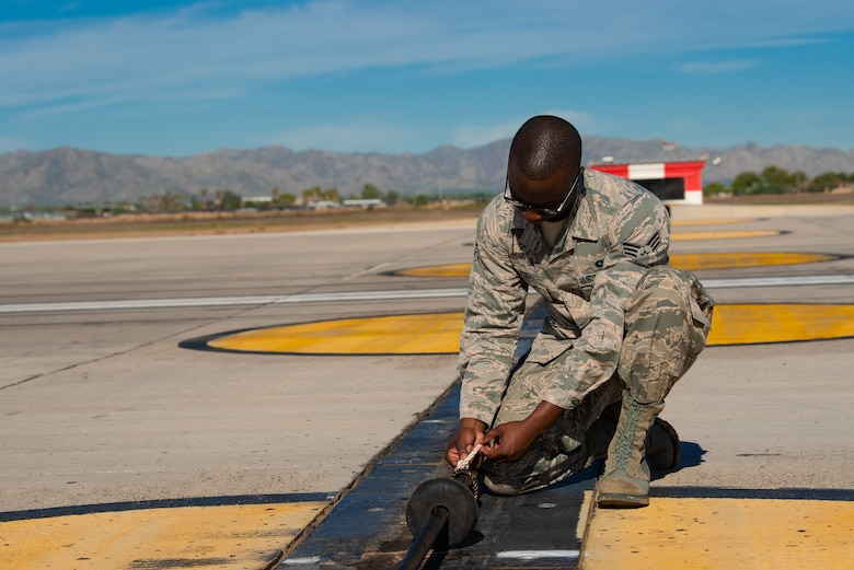 Senior Airman Derrick Beleski, 56th Operation Support Squadron airfield management operations supervisor, looks over a safety cable system, Oct. 24, 2018, at Luke Air Force Base, Ariz.