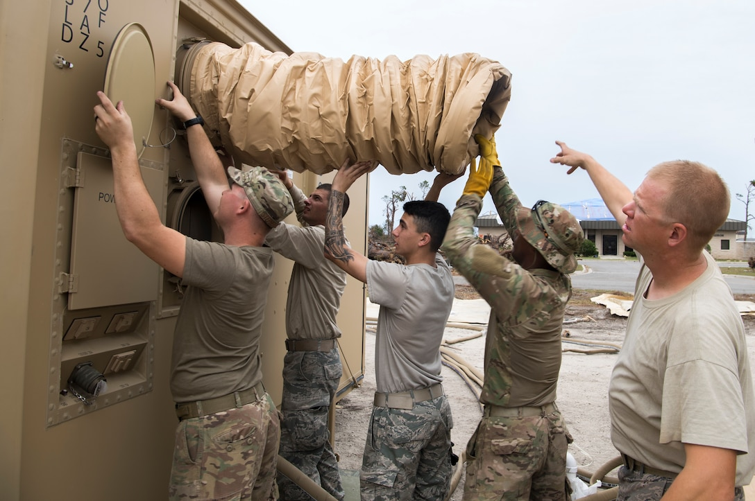 U.S. Air Force Airmen install air conditioning units