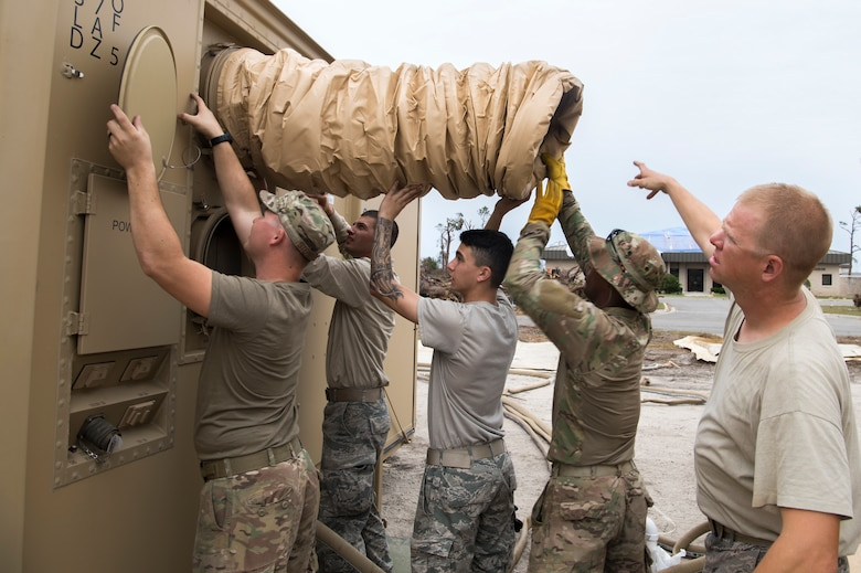 U.S. Air Force Airmen install air conditioning units