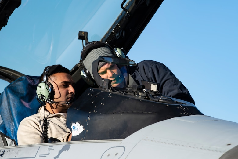 Staff Sgt. Mark Ward mentors Senior Airman Bheem Zohar as they conduct a flight control built in test for an F-16 Fighting Falcon October 25, 2018. Ward and Bheem are both crew chiefs assigned to the 80th Aircraft Maintenance Unit, which is at Eielson Air Force Base, Alaska participating in exercise Distant Frontier. Distant Frontier is a continuation of the training provided during RED FLAG-Alaska, but allows for a more tailored mission scenarios that can better meet participating unit's training objectives. (U.S. Air Force photo by Staff Sgt. Levi Rowse)