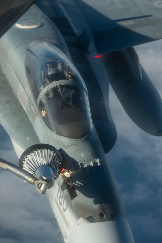 A Royal Canadian Air Force CF-188 Hornet receives fuel from a U.S. Air Force KC-135 Stratotanker during Exercise Trident Juncture 18, off the coast of Norway, Oct. 27, 2018. Trident Juncture is the largest NATO exercise since 2015, with participation of more than 50,000 military members from 31 nations. The exercise helps ensure NATO's capability to deter and defend against any adversary. (U.S. Air Force photo by Senior Airman Luke Milano)