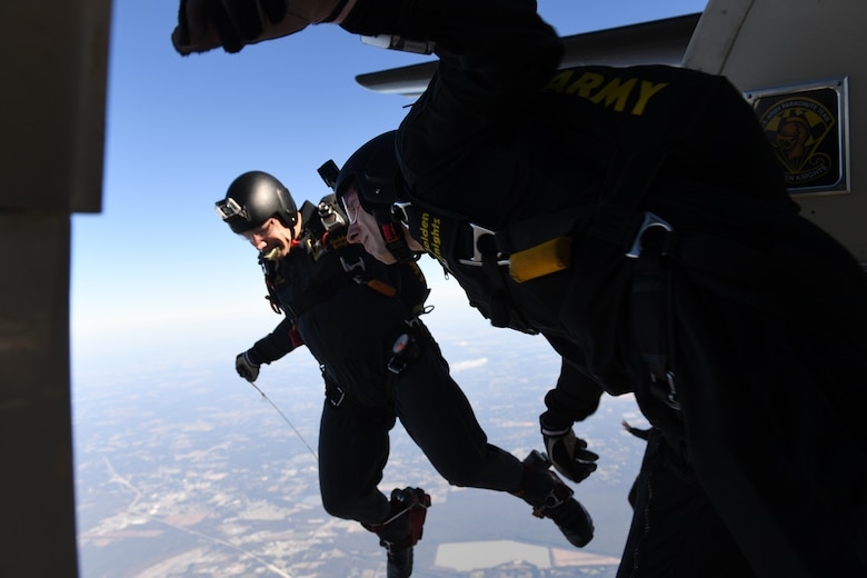 A member of the U.S. Army Golden Knights jumps out of the slide of an aircraft