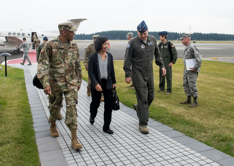 U.S. Air Force Gen. CQ Brown, Jr., Pacific Air Forces commander, his wife, Sharene, and Lt. Gen. Jerry P. Martinez, United States Forces Japan commander, walk to the 374th Distinguished Visitor Lounge