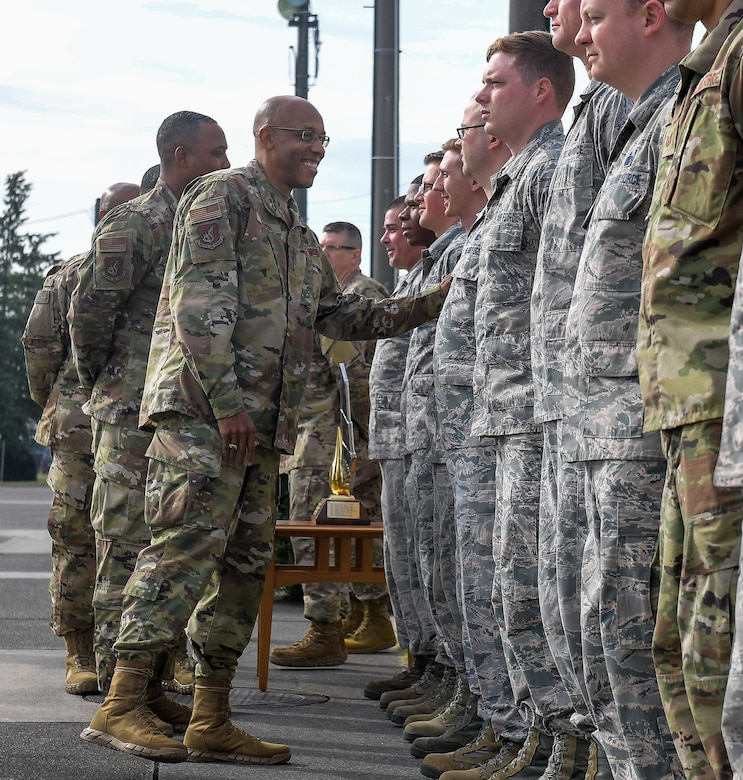 U.S. Air Force Gen. CQ Brown, Jr., Pacific Air Forces (PACAF) commander, talks with 374th Logistics Readiness Squadron Airmen, during a visit to the Petroleum, Oils and Lubricants (POL) shop