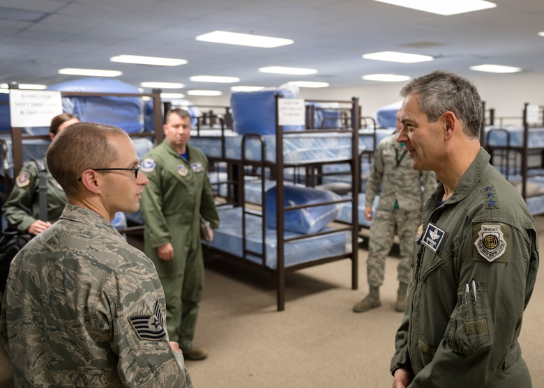 U.S. Air Force Tech. Sgt. Mark Chalmers, left, 51st Aircraft Maintenance Squadron noncommissioned officer in charge of programs, briefs Lt. Gen. Kenneth Wilsbach, Seventh Air Force commander, on beddown procedures at the 25th Fighter Squadron at Osan Air Base, Republic of Korea, Oct. 26, 2018.  Wilsbach visited the 25th FS for a mission brief and to understand how members of Osan utilize shared quarters when conducting contingency operations.  (U.S. Air Force photo by Staff Sgt. Rachel Maxwell)